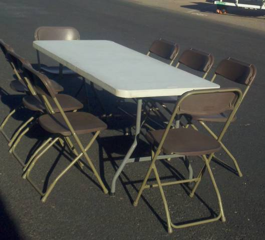 6' banquet table and 8 brown folding chairs