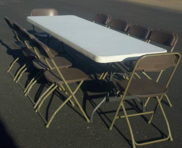 8' banquet table and 10 brown folding chairs