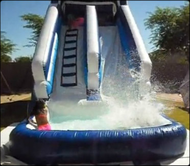 18' water slide and kids sliding in to pool