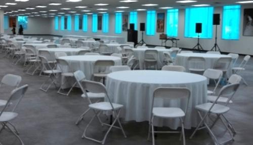 tables, chairs and tablecloth set up for wedding