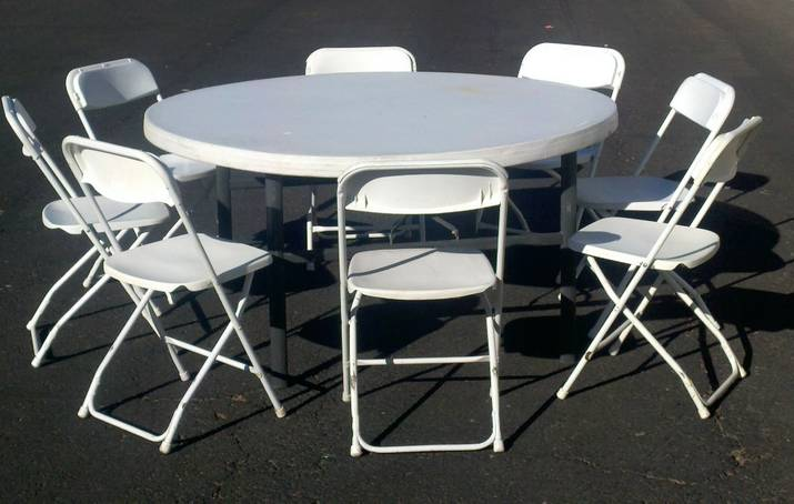 Round 60' table and 8 white folding chairs